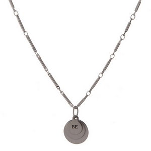 "Dainty silver tone necklace featuring stacked circle pendants, stamped with ""Be True To You."""