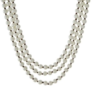 """Three row, knotted pearl necklace with brown cord. Approximately 15"""" to 18"""" in length."""
