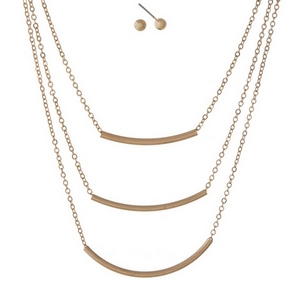 "Dainty gold tone, three layer necklace set featuring three curved bar pendants. Approximately 14"" to 18"" in length."