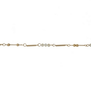 """Dainty gold tone choker featuring ivory faceted beads. Approximately 13"""" in length."""