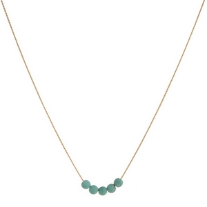"Gold tone necklace with five turquoise natural stone beads. Approximately 14"" in length."