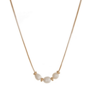"""Gold tone necklace with three freshwater pearl beads. Approximately 16"""" in length."""