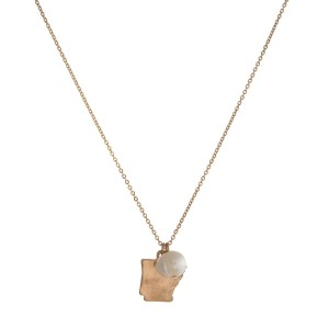 "Dainty gold tone necklace with a state of Arkansas pendant and a freshwater pearl accent. Approximately 16"" in length."