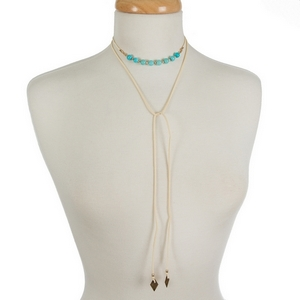 """Ivory faux suede wrap choker featuring turquoise beads. Approximately 12"""" in length."""