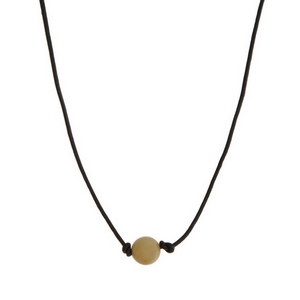 """Brown leather cord necklace with an amazonite natural stone bead. Approximately 16"""" in length."""