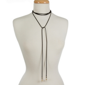 """Black faux suede wrap necklace featuring clear natural stones on the ends. Approximately 12"""" and 21"""" in length."""