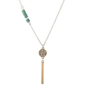 """Two sided, silver and gold tone necklace with mint green accents and a bar pendant stamped with """"Loved."""""""