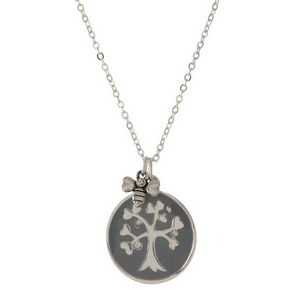 "Dainty silver tone necklace featuring a double sided pendant, stamped with ""Family is Forever"" on one side. Approximately 16"" in length."