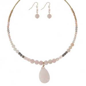 """Gold tone memory wire choker set featuring pink and rose quartz natural stones and matching fishhook earrings. Approximately 6"""" in diameter."""
