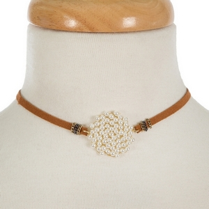 """Brown suede choker featuring a gold tone, wire wrapped pearl focal. Approximately 114"""" in length."""