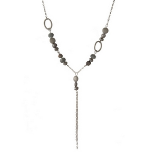 "Silver tone necklace featuring gray and opal beads and a dainty chain tassel. Approximately 18"" in length."
