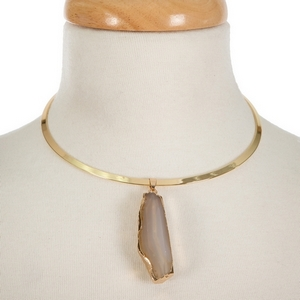 """Gold tone metal choker featuring a gray and ivory natural stone pendant. Approximately 5/5"""" in diameter."""