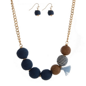 """Gold tone necklace set navy blue thread wrapped balls and a tassel accent. Approximately 16"""" in length."""