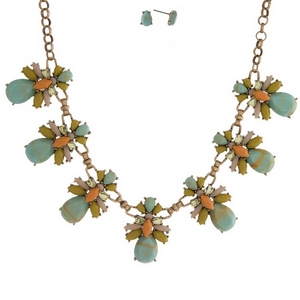 """Gold tone necklace set with mint green and gold swirled stones, accented with peach and blush rhinestones and matching stud earrings. Approximately 16"""" in length."""