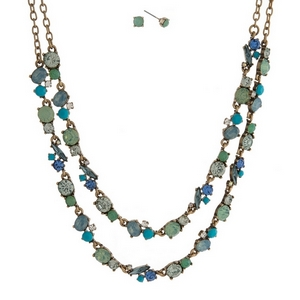 """Burnished gold tone necklace set with two layers of mint green, blue and turquoise rhinestones and matching stud earrings. Approximately 16"""" in length."""