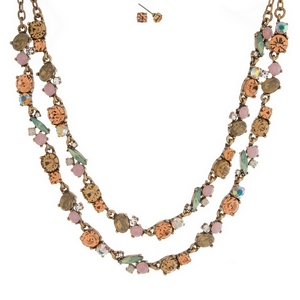 """Burnished gold tone necklace set with two layers of peach, pale pink and mint green rhinestones and matching stud earrings. Approximately 16"""" in length."""