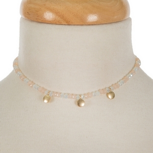 """Peach and opal beaded choker with gold tone circle accents. Approximately 12"""" in length."""