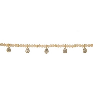 """Gold tone choker featuring ivory beads and clear rhinestone accents. Approximately 12"""" in length."""