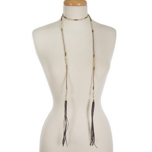 "Ivory and gray beaded wrap necklace with gray faux suede tassels on the ends. Approximately 50"" in length."