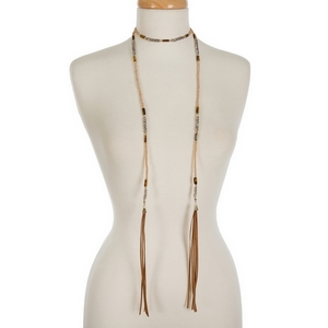"""Champagne and gray beaded wrap necklace with brown faux suede tassels on the ends. Approximately 50"""" in length."""