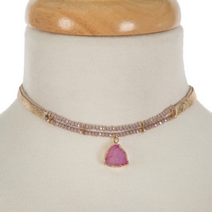 """Gold leather choker featuring purple iridescent faceted beads and a purple druzy stone pendant. Approximately 12"""" in length."""