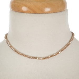 """Gold tone, dainty choker featuring gray faceted beads. Approximately 12"""" in length."""