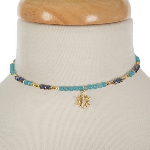 """Gold tone memory wire choker featuring turquoise and blue iridescent beads and a star pendant. Approximately 5"""" in diameter. Handmade in the USA."""