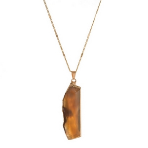"""Gold tone necklace featuring a gray natural stone pendant. Approximately 32"""" in length."""