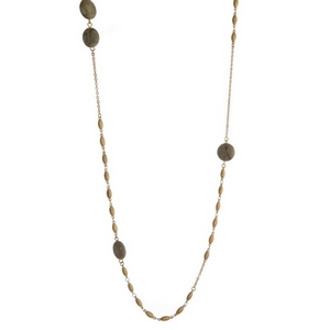 """Gold tone necklace featuring gray natural stones. Approximately 38"""" in length."""