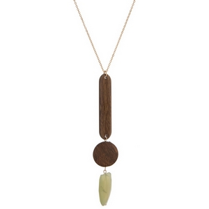 """Gold tone necklace featuring two wooden pendants and a light green faceted stone. Approximately 30"""" in length."""