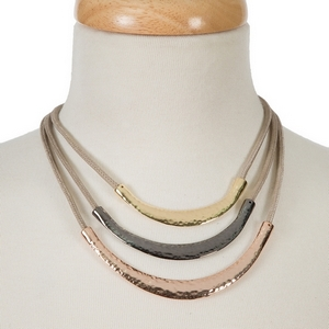 "Taupe three layer necklace featuring gold, hematite and rose gold tone hammered bars. Approximately 14"" to 16"" in length."
