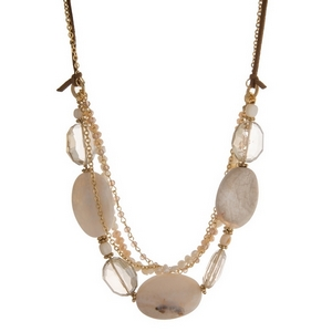 """Gold tone and brown faux suede necklace featuring ivory, champagne and freshwater pearl beads and natural stones. Approximately 24"""" in length."""