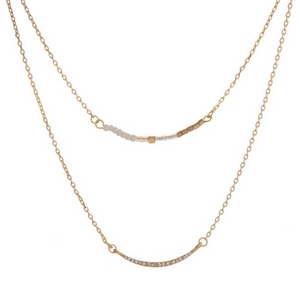"""Dainty gold tone two layer necklace featuring a peach beaded bar pendant and clear rhinestone pave bar pendant. Approximately 13"""" and 16"""" in length."""