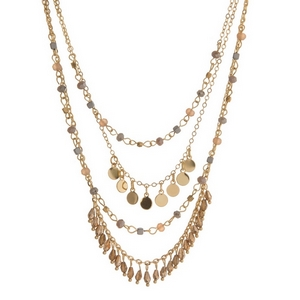 "Gold tone layered necklace featuring champagne, bronze and ivory beads. Approximately 16"" to 20"" in length."