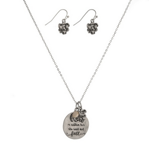 "Silver tone necklace set featuring circle pendant stamped with ""God in within her, she will not fall"" with matching fishhook earrings. Approximately 16"" in length."