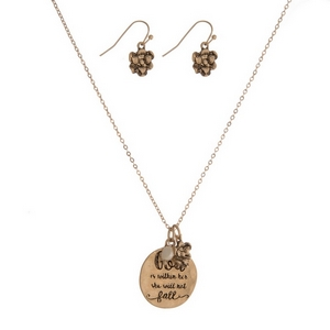 "Gold tone necklace set featuring circle pendant stamped with ""God in within her, she will not fall"" with matching fishhook earrings. Approximately 16"" in length."