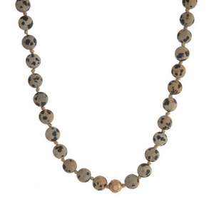"Dalmatian jasper natural stone beaded necklace with gold tone accents. Approximately 16"" in length."
