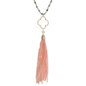 """Gray knotted cord necklace featuring gray faceted beads, sesame jasper natural stone beads, an open clover shape, and a pale pink fabric tassel. Approximately 34"""" in length."""