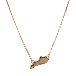 "Dainty gold tone necklace featuring a faux druzy stone pendant in the shape of Kentucky. Approximately 16"" in length."