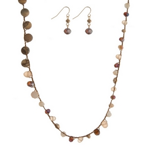 """Brown cord toggle necklace featuring ivory and brown faceted beads, picture jasper natural stone beads, and a gold tone toggle closure. Approximately 18"""" in length."""