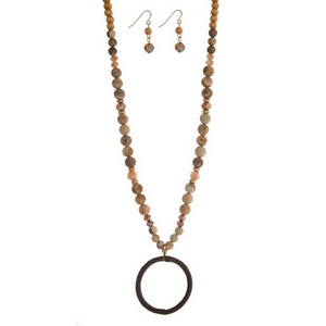 """Brown wooden and picture jasper natural stone beaded necklace set featuring an open circle pendant, gold tone accents and matching fishhook earrings. Approximately 34"""" in length."""