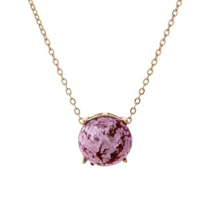 """Gold tone necklace with a pink glitter, circle pendant. Approximately 16"""" in length."""
