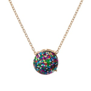"""Gold tone necklace with a multi colored glitter, circle pendant. Approximately 16"""" in length."""