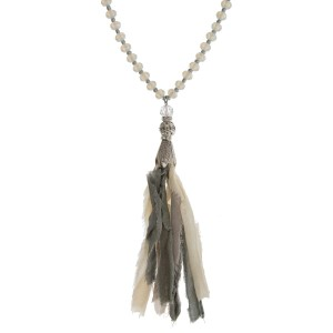 """Ivory and opal beaded necklace with a gray fabric tassel and silver tone accents. Approximately 32"""" in length."""