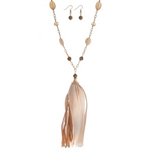 """Gold tone necklace set with topaz and picture jasper beads and a tan fabric tassel. Approximately 36"""" in length."""