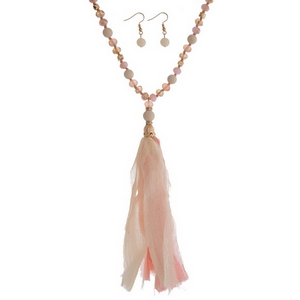 """Pale pink natural stone and faceted bead necklace with an ivory and pink fabric tassel. Approximately 32"""" in length."""