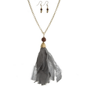 """Gold tone necklace set with a gray fabric pendant and matching fishhook earrings. Approximately 32"""" in length. Tassel is approximately 5.5"""" in length."""