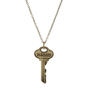 "Gold tone necklace with a key pendant, stamped with ""Blessed."" Approximately 21"" in length."