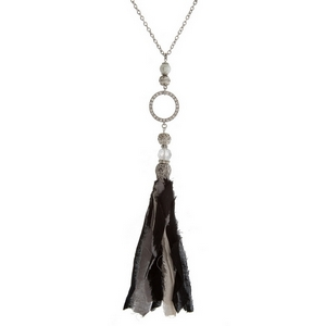 """Silver tone necklace with a black and gray fabric tassel. Approximately 33"""" in length."""