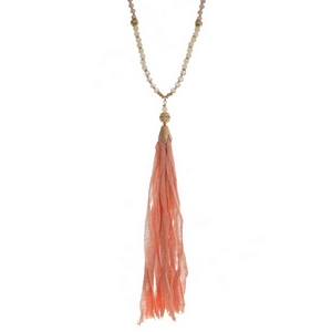 """Gold tone necklace with a pink beaded chain and a pink fabric tassel. Necklace is approximately 34"""" in length and tassel is 8"""" in length."""
